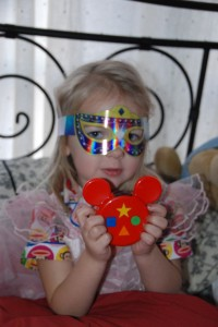 Eva Enjoying her Minnie Masquerade Mask and her Mickey Mote