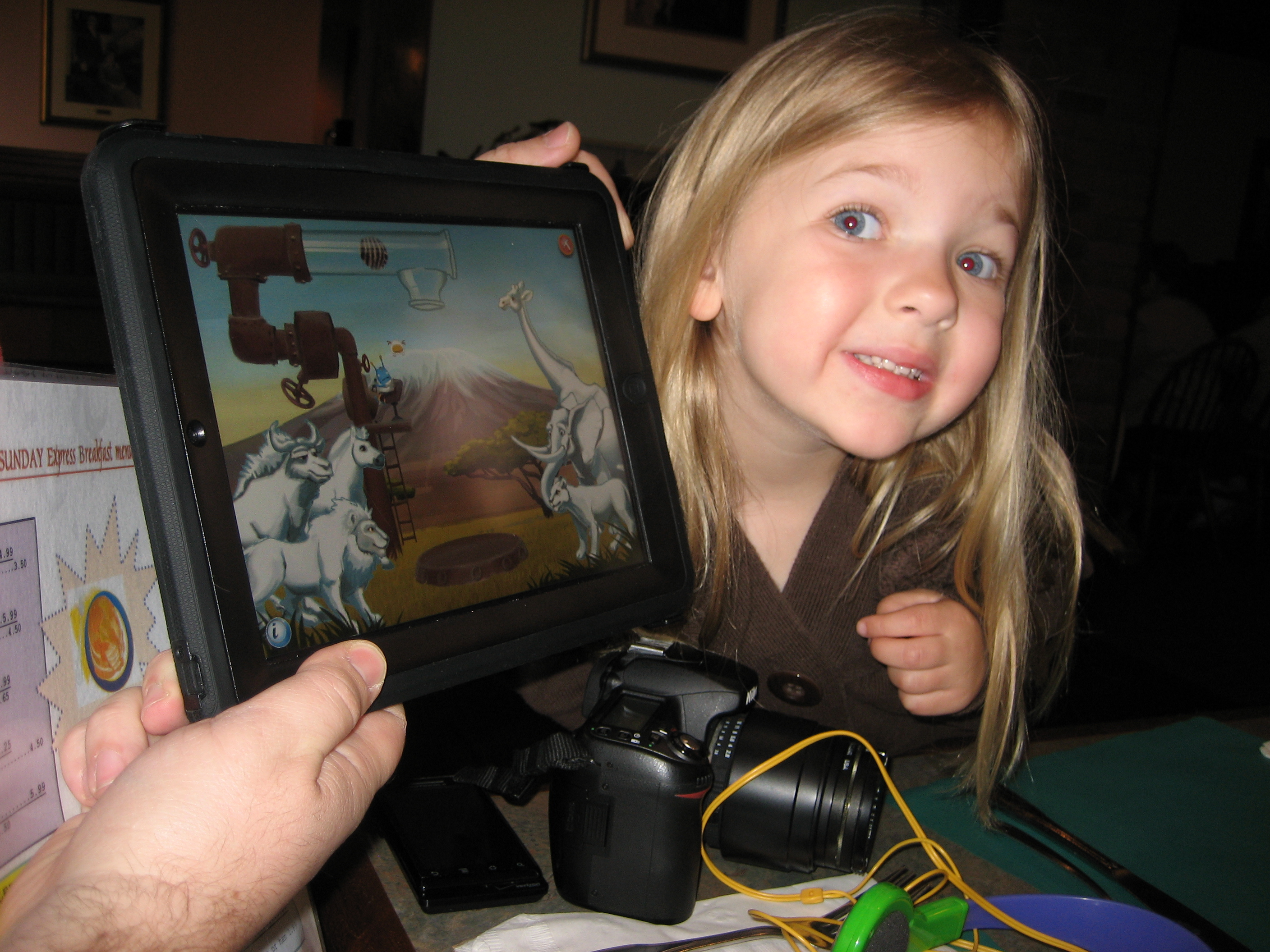 Eva showing off Ansel and Clair's Adventures in Africa game.