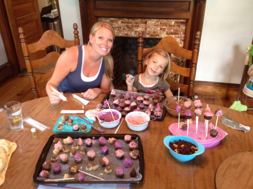 Shelby and Eva making cake pops