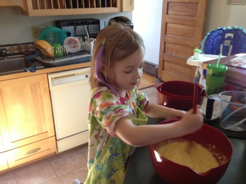 Eva stirring the batter