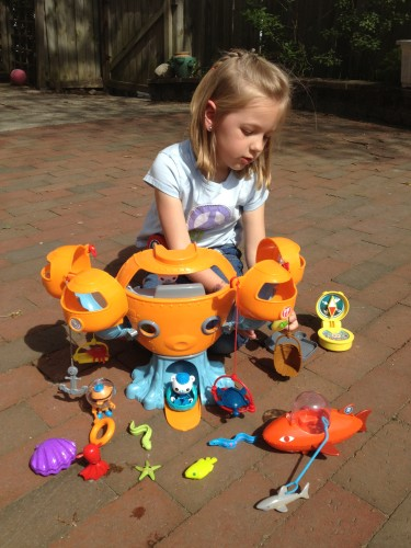 Eva playing with her Octonauts