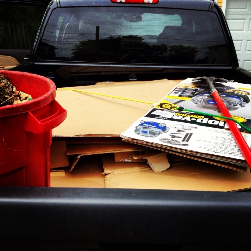The GMC Sierra Denali with a loaded bed of cardboard and Styrofoam