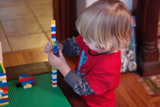 Andrew building a LEGO tower.