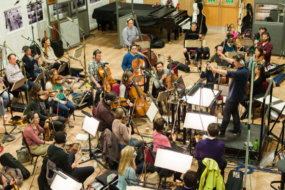 Wide view of Philip Sheppard conducting the orchestra