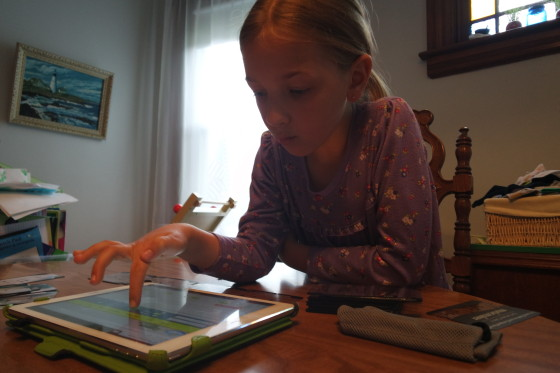 Eva testing out her song on the iPad.