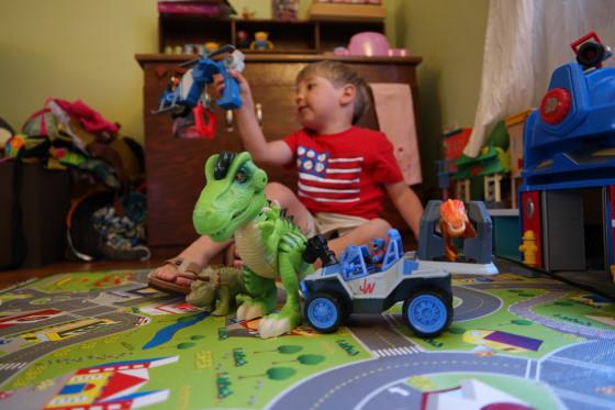 Andrew Enjoying some Jurassic World Toys