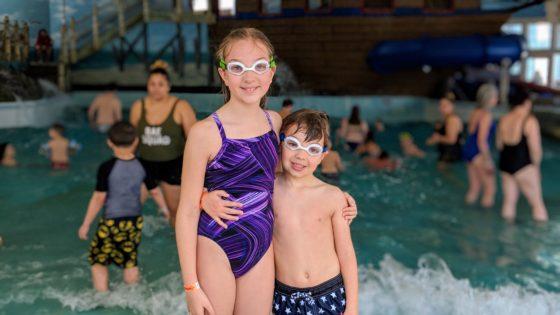 Happy Siblings at the Wave Pool