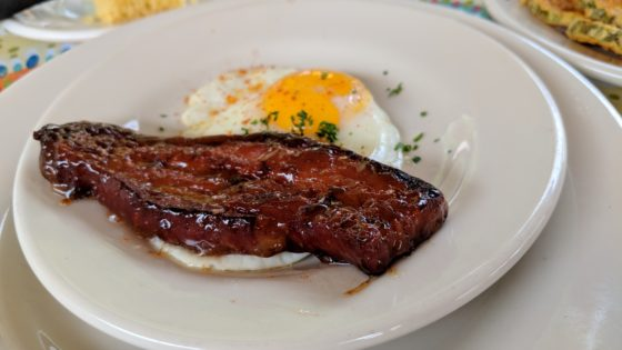 Candy Laquered Bacon Strip with a fried egg